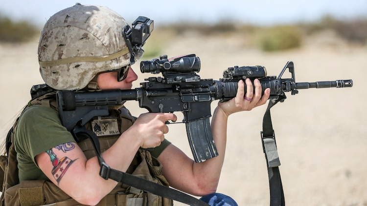 Brandi Pompa, wife of Sgt. Isaac Pompa, scouts, Alpha Company, 1st Tank Battalion, fires an M16A4 service rifle during the unit's Jane Wayne Spouse Appreciation Day aboard the Marine Corps Air Ground Combat Center, Twentynine Palms, Calif., April 3, 2018. The purpose of the event is to build resiliency in spiritual well being, the will to fight and a strong home life for the 1st Tanks Marines and their families. (U.S. Marine Corps photo by Lance Cpl. Rachel K. Porter)