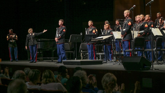 U.S. Marines with the 1st Marine Division Band, stand after a performance during the 1st Marine Division Band's 10th annual concert at the California Center for the Arts, Escondido, Calif., March 29, 2018.