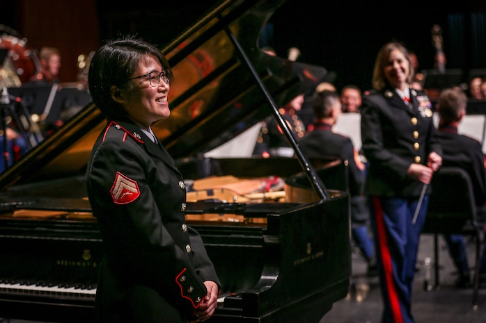 "U.S. Marine Corps Cpl. Seungyen Shin, a musician keyboardist for 1st Marine Division Band, stands after performing ""Rhapsody in Blue"" during the 1st Marine Division Band's 10th annual concert at the California Center for the Arts, Escondido, Calif., March 29, 2018."
