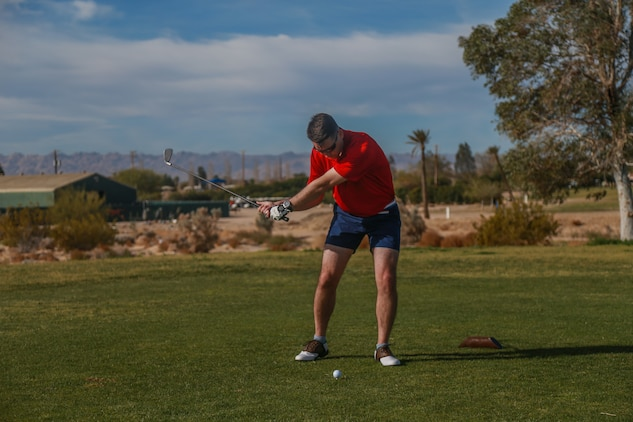 Maj. Kieran O'Neil, instructor, Marine Corps Logistics Operations Group, tees off at the first-ever True Grit Tournament at the Desert Winds Golf Course aboard the Marine Corps Air Ground Combat Center, Twentynine Palms, Calif., April 6, 2018. The tournament was held to raise money for MCLOG's Marine Corps Birthday Ball while building relations between the host unit and other units on base. (U.S. Marine Corps photo by Lance Cpl. Preston L. Morris)