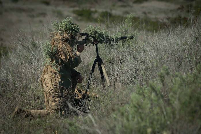 A U.S. Marine with Force Company, 1st Reconnaissance Battalion, 1st Marine Division, sights in during a pre-sniper training exercise at Marine Corps Base Camp Pendleton, Calif., March 26, 2018.