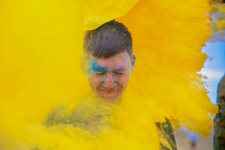 A Marine is covered in colored powder during the Sexual Assault Prevention and Response annual Colorful Consent Run held aboard the Marine Corps Air Ground Combat Center, Twentynine Palms, Calif., April 6, 2018. The goal of the 5k color fun run was to have everyone gather to spread awareness while still having fun. (U.S. Marine Corps Photo by Cpl. Christian Lopez)