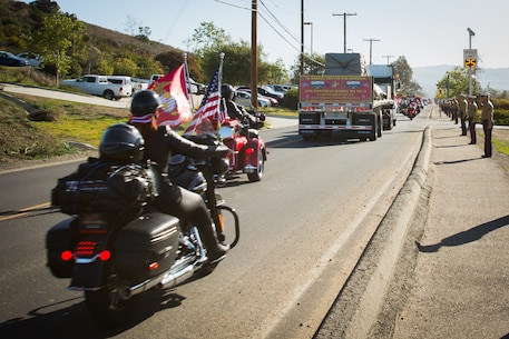 Patriot Guard Riders of Southern California with American Legion Riders escort the 5th Marines Vietnam War Memorial at Marine Corps Base Camp Pendleton, Calif., March 29, 2018.