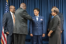 Family members of Joyce Gordon, state judge advocate for Headquarters, Kentucky Air National Guard, pin colonel's rank insignia to her uniform during a promotion ceremony April 14, 2018, at the Kentucky Air National Guard Base in Louisville, Ky