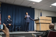 Newly promoted Col. Joyce Gordon, state judge advocate for Headquarters, Kentucky Air National Guard, speaks to the audience during her promotion ceremony at the Kentucky Air National Guard Base in Louisville, Ky., April 14, 2018.
