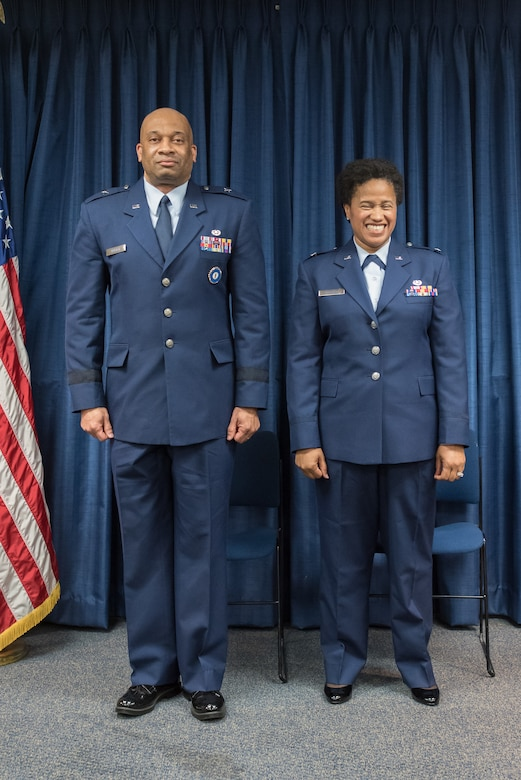 Joyce Gordon (right), state judge advocate for Headquarters, Kentucky Air National Guard, is promoted to the rank of colonel during a ceremony at the Kentucky Air National Guard Base in Louisville, Ky., April 14, 2018. The event was officiated by Brig. Gen. Charles Walker (left), chief off staff for Headquarters, Kentucky Air National Guard.