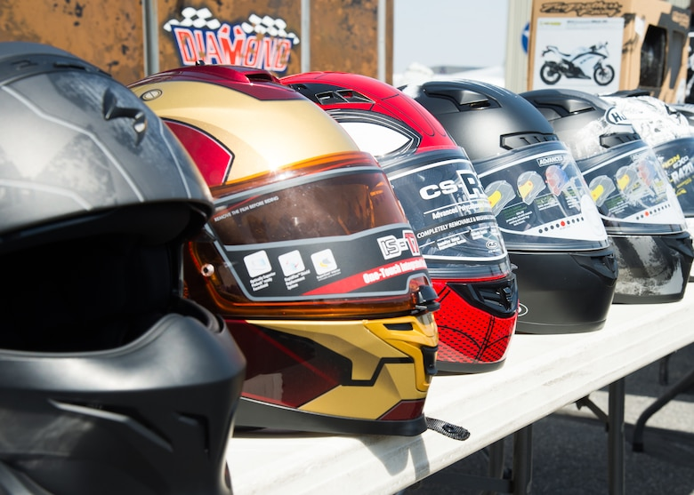 A line of safety helmets are on display during Motorcycle Safety Day April 13, 2018, at Dover Air Force Base, Del. There is no Delaware State law requiring riders to wear a helmet but Department of Defense Instructions require all military and DOD civilian personnel wear a helmet while operating or riding on a motorcycle whether on or off a DOD installation.  (U.S. Air Force photo by Mauricio Campino)
