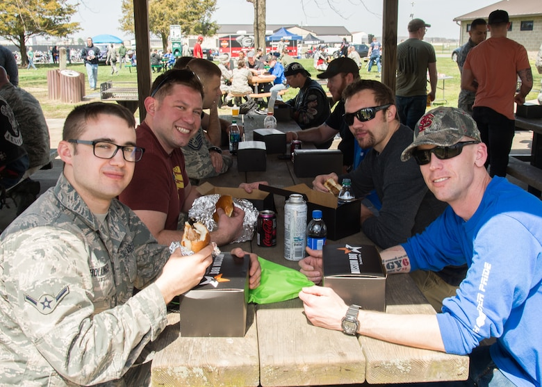 Attendees enjoy a free lunch during Motorcycle Safety Day April 13, 2018, at Dover Air Force Base, Del. The local Mission BBQ restaurant donated 175 boxed lunches and the Dover Air Force Base Chaplain Corps provided free drinks and snacks. (U.S. Air Force photo by Mauricio Campino)