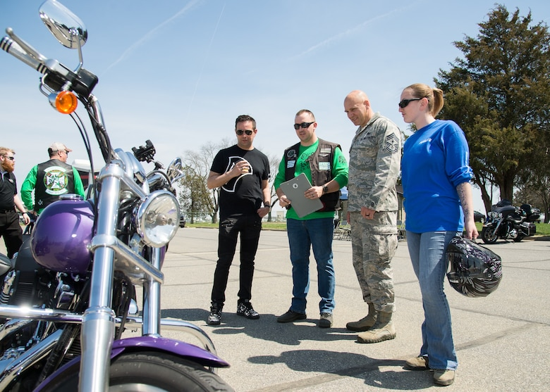 Staff Sgt. Nicole Lesmerises, 436th Maintenance Squadron aerospace propulsion craftsman, has her motorcycle inspected by contest judges Todd McNabney, owner and creative designer of Heroic Racing Apparel, Staff Sgt. Zach Fannin, 9th Airlift Squadron C-5M Super Galaxy loadmaster and president of the Green Knights Motorcycle Club Chapter 49, and Chief Master Sgt. Anthony Green, 436th Airlift Wing command chief, at the Motorcycle Safety Day April 13, 2018, at Dover Air Force Base, Del. Prizes were awarded for seven different categories. (U.S. Air Force photo by Mauricio Campino)