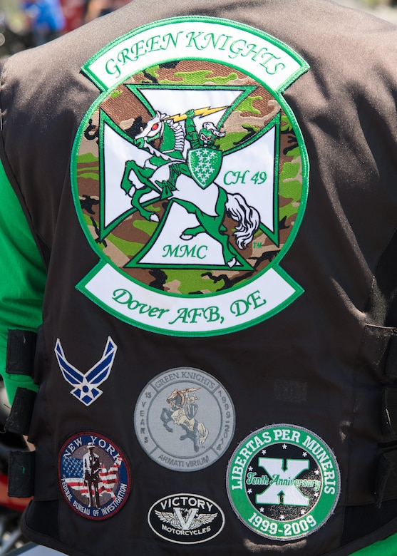 Stylized patches cover a motorcycle vest belonging to Staff Sgt. Zach Fannin, 9th Airlift Squadron C-5M Super Galaxy loadmaster and president of the Green Knights Motorcycle Club Chapter 49, at the Motorcycle Safety Day April 13, 2018, at Dover Air Force Base, Del. The Green Knights are one of the sponsors for the annual event. (U.S. Air Force photo by Mauricio Campino)