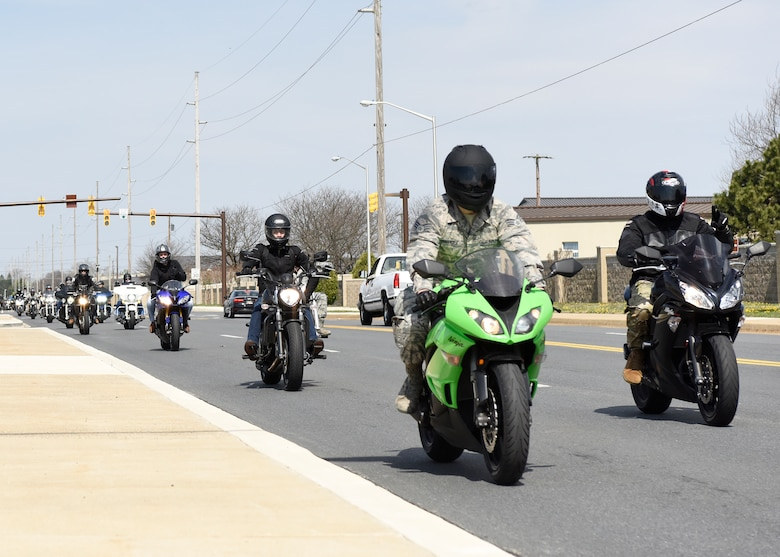 Motorcycle Safety Day attendees participate in a group ride April 13, 2018, at Dover Air Force Base, Del. The group cruised through the base and finished at the Motorcycle Safety Foundation range for a social event.  (U.S. Air Force photo by Airman 1st Class Zoe m. Wockenfuss)