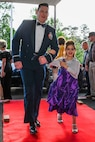 U.S. Air Force 2nd Lt. James Golden, the executive officer of the 343rd Bomb Squadron, Barksdale Air Force Base, Louisiana, escorts children into the El Karubah Shriners' Memories in Wonderland Ball April 14, at the Shriners' Clubhouse in Shreveport, La., April 14, 2018.