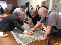 York Mayor Michael Helfrich, at left, points out areas on a map related to potential future development, areas of concern and opportunities along the Codorus Creek Flood Risk Management System during a stakeholder meeting held at York College in York, Pennsylvania, April 10, 2018. Also pictured, at right, Ray Tracy, U.S. Army Corps of Engineers, Baltimore District, civil engineer; and, second from right, Jehu Johnson, Baltimore District Levee Safety Program manager. The purpose of this stakeholder meeting was for attendees to learn more about this project and brainstorm items that could be incorporated into the comprehensive plan for the project.