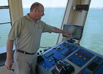 Dredge McFarland Captain Mitch Tillyard points to a survey of shoaled areas in the shipping channel that the vessel must clear. The McFarland, one of four ocean-going hopper dredges owned and operated by the U.S. Army Corps of Engineers, conducted urgent dredging in Morehead City, N.C. in March and April of 2018. The McFarland is based out of the USACE Philadelphia District