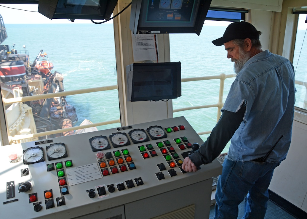 Dredge McFarland Marine machinery mechanic and drag tender Ray Bailey prepares to lower a drag arm. The McFarland, one of four ocean-going hopper dredges owned and operated by the U.S. Army Corps of Engineers, conducted urgent dredging in Morehead City, N.C. in March and April of 2018. The McFarland is based out of the USACE Philadelphia District.