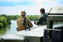 A Texas Guardsmen and a Customs and Border Patrol agent discuss the lay of the land April 10 on the shores of the Rio Grande River  in Starr County, Texas as part of the federal call-up to the Texas Mexico border. Soldiers called to duty at the border support federal partners and primarily serve in observe-and-report roles.