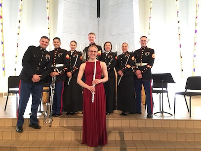 Jessica Backes, a Gustavus Adolphus College music performance major and Marine enlistee, poses for a photo alongside members of the 2nd Marine Division Band Woodwind Quintet, after her senior flute recital, Sunday, April 15, in St. Peter, Minn. Backes will graduate June with honors before leaving for Marine Corps recruit training at Marine Corp Recruit Depot Parris Island, S.C. Once training is complete, Backes will be permanently assigned to one of the 10 performing Marine Corps bands.