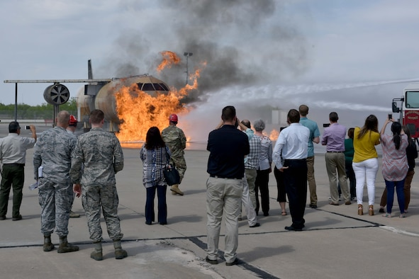 Members from Leadership San Angelo watch a firefighting demonstration at the Louis F. Garland Department of Defense Fire Academy on Goodfellow Air Force Base, Texas, April 12, 2018. Trainees use the controlled fires as a hands-on training experience. (U.S. Air Force photo by Senior Airman Randall Moose/Released)