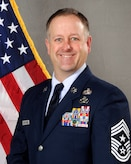 Official portrait of Chief Master Sergeant Patrick Armstrong.