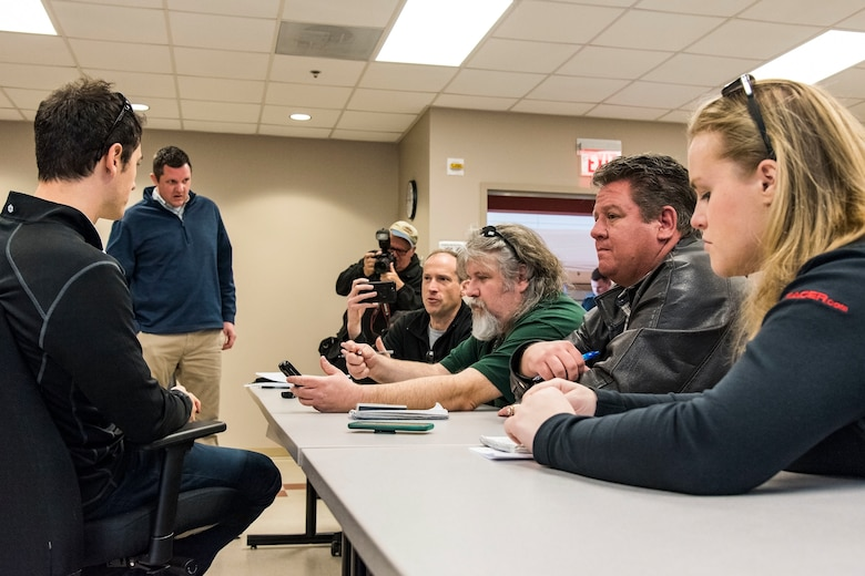 Joey Logano, driver of the No. 22 Ford in the Monster Energy NASCAR Cup Series, speaks with members of the media during a question and answer session April 11, 2018, at Dover Air Force Base, Del. The media session was held inside the training room located at the 436th Operations Support Squadron aircrew flight equipment facilities. (U.S. Air Force photo by Roland Balik)