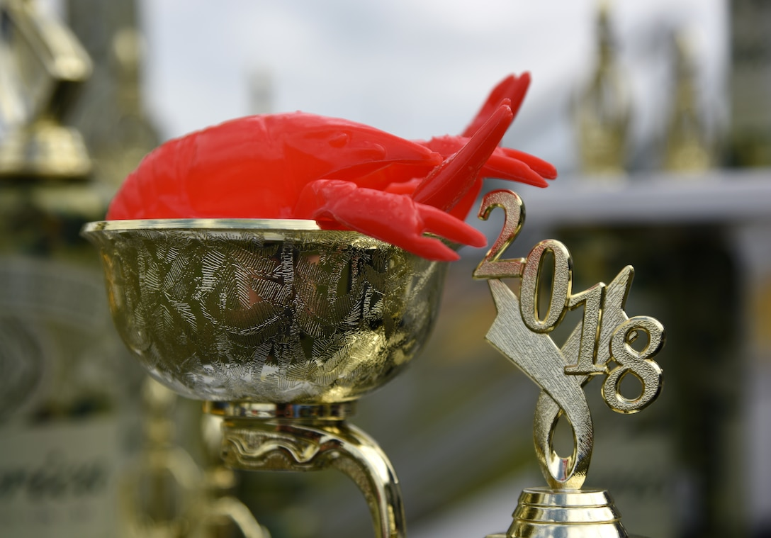 "Trophies are displayed during the 6th Annual Bay Breeze Crawfish Cook-Off at the Bay Breeze Event Center at Keesler Air Force Base, Mississippi, April 13, 2018. The ""Craw-Fish Pot-Nahs"" won first place overall and a free entry into the 26th Annual Mississippi Coast Coliseum Crawfish Festival Cook-Off. Twenty-one teams competed in the event. (U.S. Air Force photo by Kemberly Groue)"