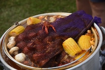 """A pot of boiled crawfish and the 'fixins' soak in seasonings during the 6th Annual Bay Breeze Crawfish Cook-Off at the Bay Breeze Event Center at Keesler Air Force Base, Mississippi, April 7, 2017. The """"Craw-Fish Pot-Nahs"""" won first place overall and a free entry into the 26th Annual Mississippi Coast Coliseum Crawfish Festival Cook-Off. Over 800 Keesler personnel attended the event. (U.S. Air Force photo by Kemberly Groue)"""
