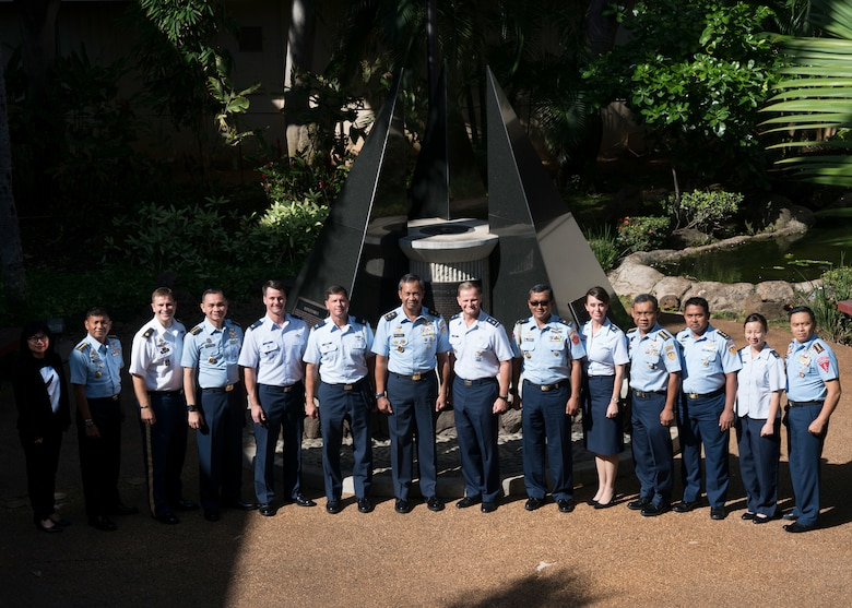 (Center Right) U.S. Air Force Maj. Gen Russell Mack, Pacific Air Forces (PACAF) deputy commander, (Center Left) Indonesian Air Vice Marshal Umar Sugeng Haryono and the attendees of the U.S. and Indonesian Airman-to-Airman (A2A) talks pose for a group photo in the Courtyard of Heroes at Joint Base Pearl Harbor-Hickam, Hawaii, April 11, 2018. PACAF senior leaders hosted Indonesian air force leaders to discuss common regional security challenges. The A2A talks are intended to increase cooperation with our allies and partners. (U.S. Air Force Photo/Staff Sgt. Daniel Robles)
