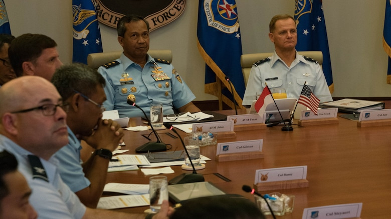 Indonesian Air Vice Marshal Umar Sugeng Haryono (left) and U.S. Air Force Maj. Gen. Russell Mack (Right) Pacific Air Forces (PACAF) deputy commander, receive a briefing during the Airman-to-Airman (A2A) talks with Indonesia at Joint Base Pearl Harbor-Hickam, Hawaii, April 11, 2018. PACAF senior leaders hosted Indonesian air force leaders to discuss common regional security challenges. The A2A talks are intended to increase cooperation with our allies and partners. (U.S. Air Force Photo/Staff Sgt. Daniel Robles)