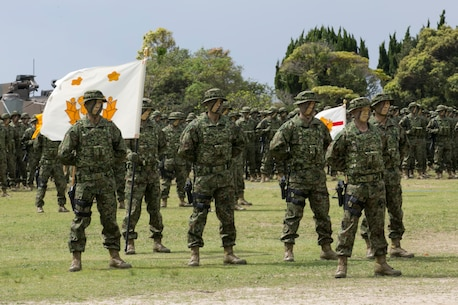 Service members with the Japan Ground Self-Defense Force stand in formation during the Japanese Amphibious Rapid Deployment Brigade's unit-activation ceremony at Camp Ainoura, Japan, April 7, 2018.