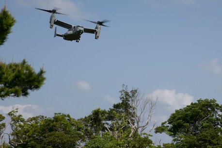 An MV-22B Osprey tiltrotor aircraft flies overhead during tactical recovery of aircraft and personnel training at Camp Hansen, Okinawa, Japan, March 26, 2018.