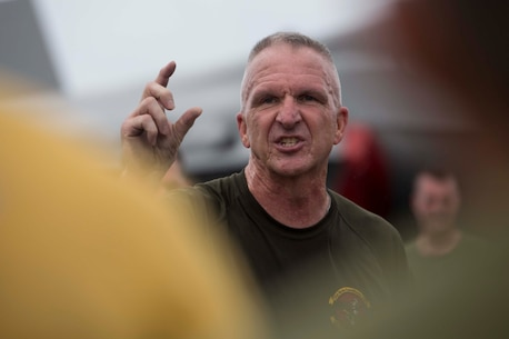 Sgt. Maj. Jim Lanham, the sergeant major of the 31st Marine Expeditionary Unit, talks to Marines and Sailors on the flight deck of the USS Wasp (LHD-1) after Sgt. Maj. PT while underway in the Philippine Sea, April 11, 2018.