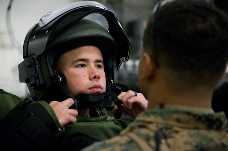 CWO2 Samuel Beltram, an Explosive Ordnance Disposal officer with Combat Logistics Battalion 31, 31st Marine Expeditionary Unit, adjusts his helmet as he prepares for a mock EOD sweep aboard the USS Wasp (LHD-1) while underway in the Pacific Ocean, April 3, 2018.