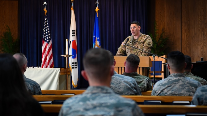 U.S. Army chaplain Michael Cohen, Holocaust Remembrance Week guest speaker, addresses an audience during a remembrance service on Osan Air Base, April 12, 2018. Cohen, a Nashville native, enlisted in the Army, served five years to become a Chaplain and pursued rabbinical studies as a reservist. From April 9 to 13, 2018, the base hosted an opening ceremony, a film screening of Conspiracy, a 5K run, and a remembrance service held at the chapel (U.S. Air Force photo by Staff Sgt. Benjamin Raughton)