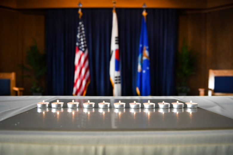 Eleven candles are lit and displayed during a remembrance service on Osan Air Base, April 12, 2018. The candles represent 11 million people murdered by Germany's Nazi regime between 1933 and 1945. From April 9 to 13, 2018, the base hosted an opening ceremony, a film screening of Conspiracy, a 5K run, and a remembrance service held at the chapel (U.S. Air Force photo by Staff Sgt. Benjamin Raughton)