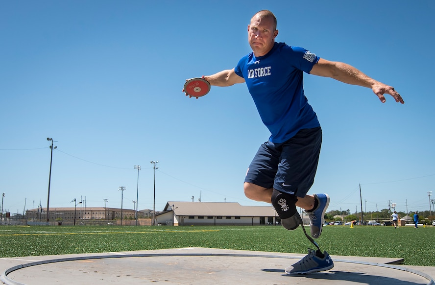 Ben Seekell, a Warrior Games athlete, goes into his discus rotation during a track and field session at the U.S. Air Force team's training camp at Eglin Air Force Base, Fla., April 16, 2018. The base-hosted, week-long Warrior Games training camp is the last team practice session before the yearly competition in June. (U.S. Air Force photo by Samuel King Jr.)