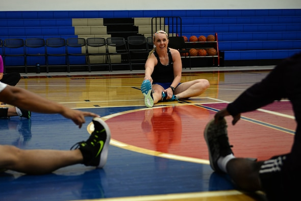Maj. Elizabeth Liebner, 36th MDOS Physical Therapy Officer, stretches with a runner's clinic class after a work-out March 21, 2018, at Andersen Air Force Base, Guam. The Andersen Physical Therapy team is implementing a new running clinic to teach and improve active duty service members running abilities April 19 at 1500, held in the Coral Reef Fitness Center basketball courts. (U.S. Air Force photo by Senior Airman Alexa Ann Henderson)