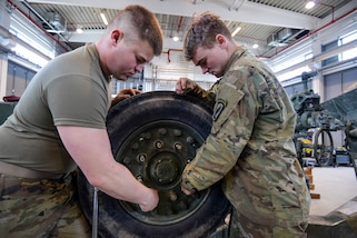 Soldiers perform maintenance on various vehicles and howitzers in the unit's motor pool at the 7th Army Training Command's Grafenwoehr Training Area, Germany, April 11, 2018. Army photo by Gertrud Zach