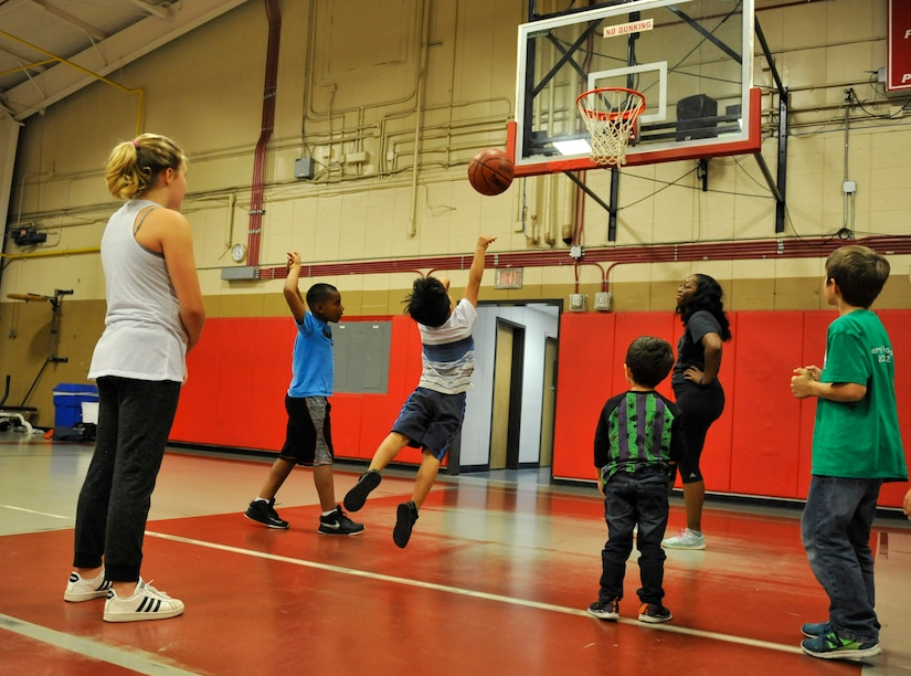 Children participating in the Hoops for Hunger basketball games take practice shots in Sam's Fitness Center at Joint Base Charleston – Weapons Station, S.C., Nov. 16, 2017.