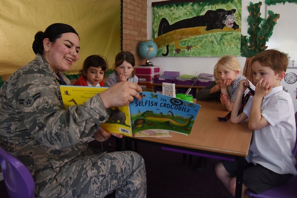 Airman 1st Class Sirinity Berganza-Campos, 48th Dental Squadron dental assistant, reads to a group of children at Brookes Cambridge school in Bury St. Edmunds, England, April 17, 2018. Six Liberty Wing Airmen visited the school to read with the students and build relationships in the community. (U.S. Air Force photo/Senior Airman Abby L. Finkel)