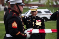 Commandant of the Marine Corps Gen. Robert B. Neller salutes during the funeral service for retired Col. Wesley Lee Fox, Medal of Honor recipient, at Arlington National Cemetery, Arlington, Va., April 17, 2018. Fox was a Korean War veteran and a 1st Sgt. prior to his commission in 1966, and he earned the Medal of Honor for his actions three years later in Vietnam. Fox retired in 1993 after forty-three years of service.