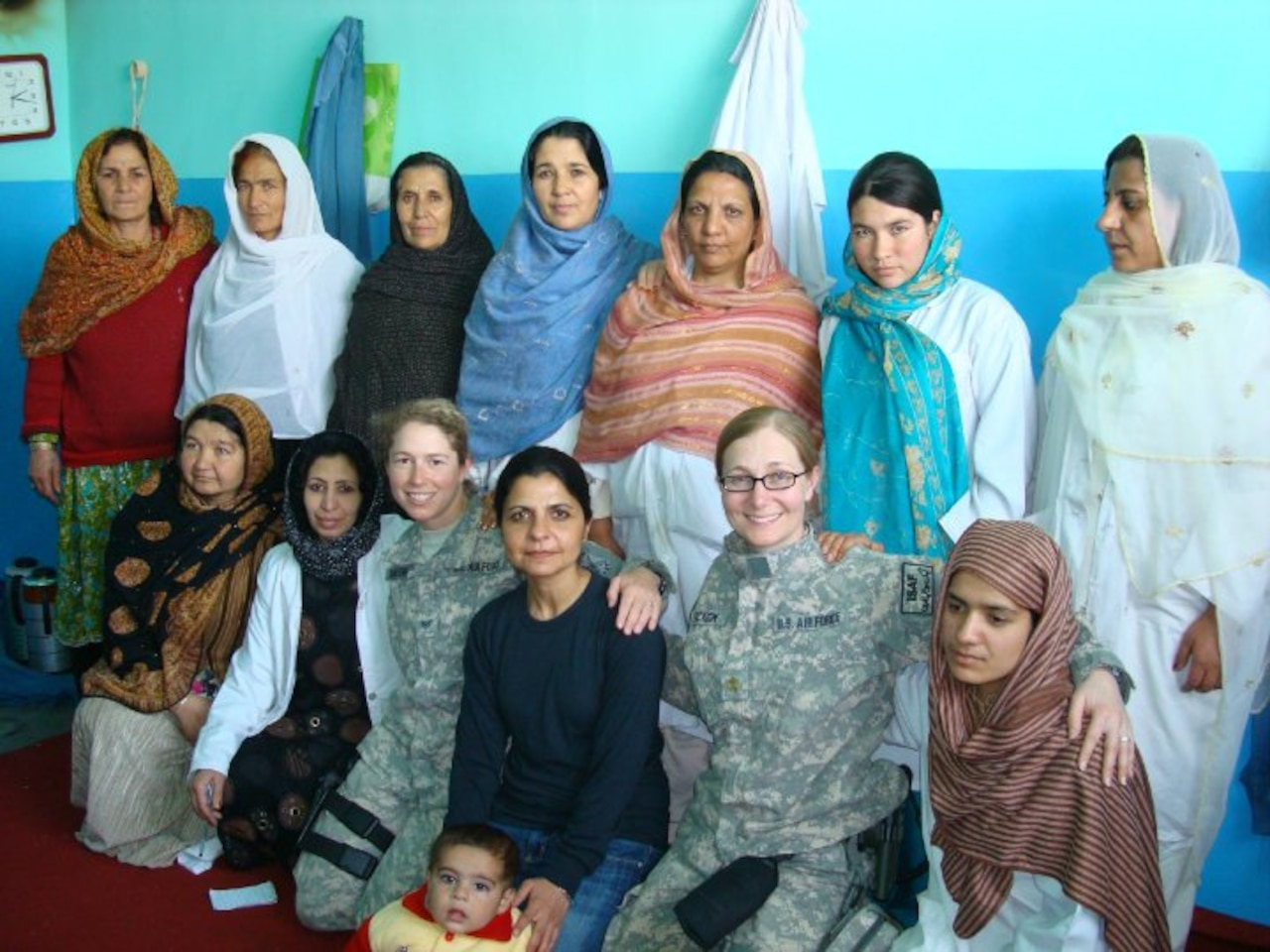 Air Force doctor poses with Afghan women.