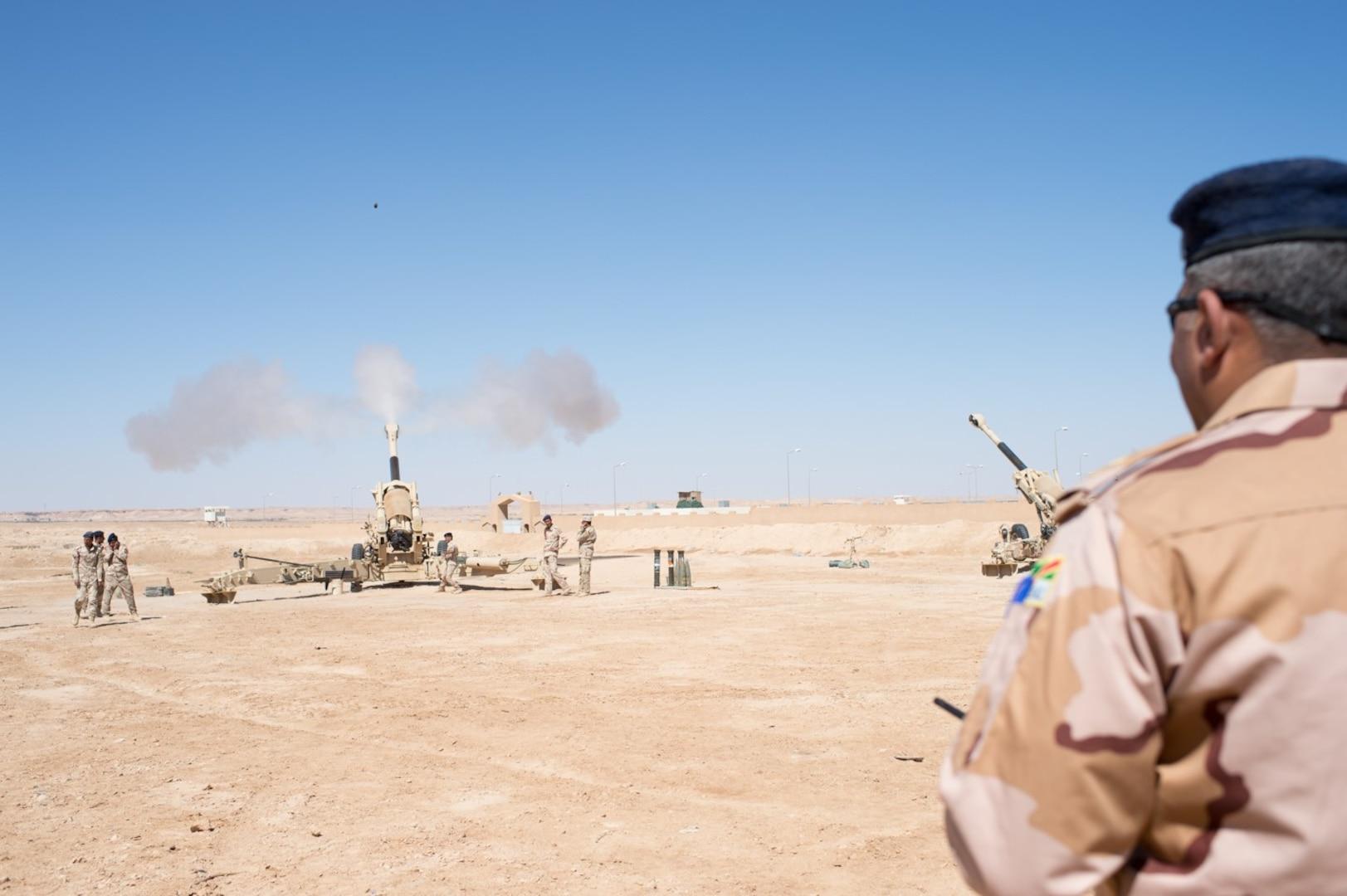 Iraqi soldier fires artillery.