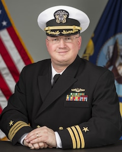 Commander Mark A. Schuchmann, USN