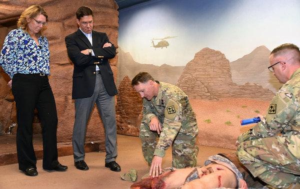 Mark T. Esper, Secretary of the Army, gets a demonstration by Maj. (Dr.) Stephen Harper at the 232nd Medical Battalion during a guided tour of the 232nd Medical Battalion 68W Advanced Individual Training, or AIT, Program for the Combat Medic Program at Joint Base San Antonio-Fort Sam Houston April 17.