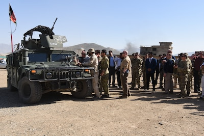 NYPD Police Commissioner James O'Neil (center) fires an M249 Squad Automatic Weapon during his visit to the Crisis Response Unit (CRU) 222 in Kabul, Afghanistan, Apr. 11, 2018. Critical Response Unit (CRU) 222 is one of three National Mission Units that fall under the command and control of the General Command Police Special Unit. CRU 222 is the primary Afghan National Defense and Security Forces (ANDSF) capability for providing rapid response to high profile attacks within Kabul and the diplomatic community.