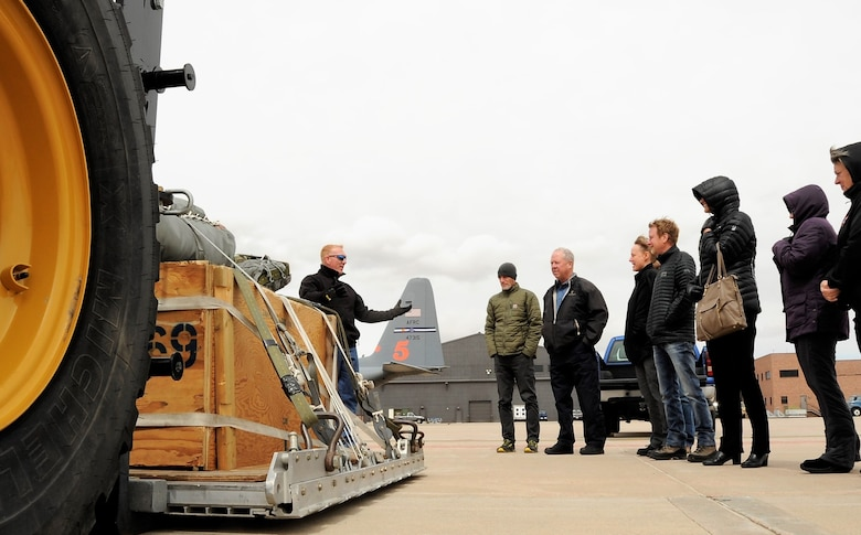 Tech. Sgt. Christopher Meyer, a 39th Aerial Port Squadron air transportation technician, explains the 39th APS aerial delivery mission to members of the 302nd Airlift Wing's Partners in Leadership program during the program's first event at Peterson Air Force Base, Colorado, April 13, 2018. The program is designed to grow existing relations between military and community leadership and is slated to feature three other events during 2018. (U.S. Air Force photo by Staff Sgt. Frank Casciotta)