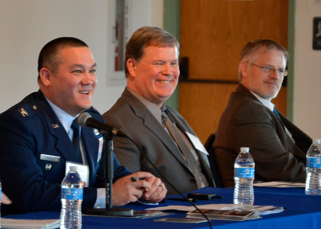 Air Force Col. Adrian Crowley, director of DLA Troop Support's Industrial Hardware supply chain, (left) speaks during the NDIA Delaware Valley Chapter International Defense Industry Conference April 13 in Philadelphia.