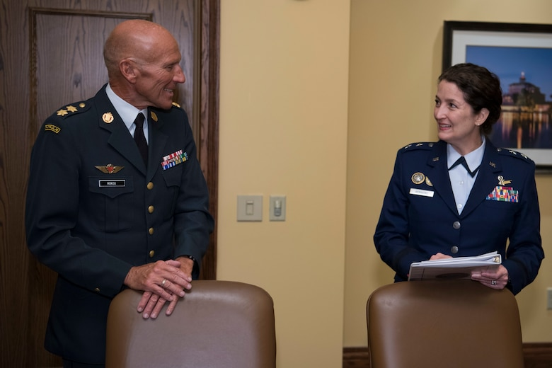 U.S. Air Force Maj. Gen. Nina Armagno (right), U.S. Strategic Command (USSTRATCOM) director of plans and policy, speaks with Maj. Gen. Agner Rokos, representing the Defence Command Denmark and the Ministry of Defence Denmark, before signing a memorandum of understanding at the 34th Annual Space Symposium Apr. 17, 2018. The memorandum authorizes sharing space situational awareness services and information with the Defence Command and Ministry of Defence for Denmark. Denmark joins 13 nations (the United Kingdom, the Republic of Korea, France, Canada, Italy, Japan, Israel, Spain, Germany, Australia, the United Arab Emirates, Belgium and Norway), two intergovernmental organizations (the European Space Agency and the European Organization for the Exploitation of Meteorological Satellites) and more than 65 commercial satellite owner/operator/launchers already participating in SSA data-sharing agreements with USSTRATCOM.