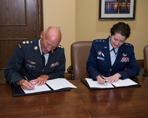 U.S. Air Force Maj. Gen. Nina Armagno (right), U.S. Strategic Command (USSTRATCOM) director of plans and policy, signs a memorandum of understanding at the 34th Annual Space Symposium Apr. 17, 2018, with Maj. Gen. Agner Rokos, representing the Defence Command Denmark and the Ministry of Defence Denmark. The memorandum authorizes sharing space situational awareness services and information with the Defence Command and Ministry of Defence for Denmark. Denmark joins 13 nations (the United Kingdom, the Republic of Korea, France, Canada, Italy, Japan, Israel, Spain, Germany, Australia, the United Arab Emirates, Belgium and Norway), two intergovernmental organizations (the European Space Agency and the European Organization for the Exploitation of Meteorological Satellites) and more than 65 commercial satellite owner/operator/launchers already participating in SSA data-sharing agreements with USSTRATCOM.