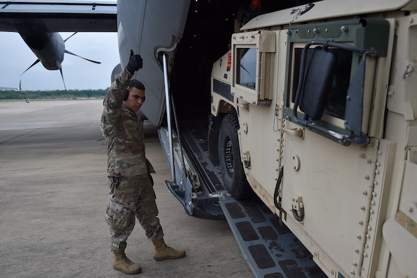 U.S. Army paratroopers from the 2nd Brigade Combat Team, 82nd Airborne Division, stationed at Fort Bragg, N.C., prepare to load onto C-130 Hercules aircraft, during the Joint Readiness Training Center exercise, April 7, 2018, at the Alexandria International Airport, La. The mission of the 2nd Brigade Combat Team is to deploy worldwide on short notice, execute a parachute assault and conduct combat operations. (U.S. Air Force photo by Tech. Sgt. Liliana Moreno/Released)